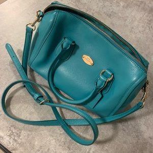 Turquoise cross body coach purse